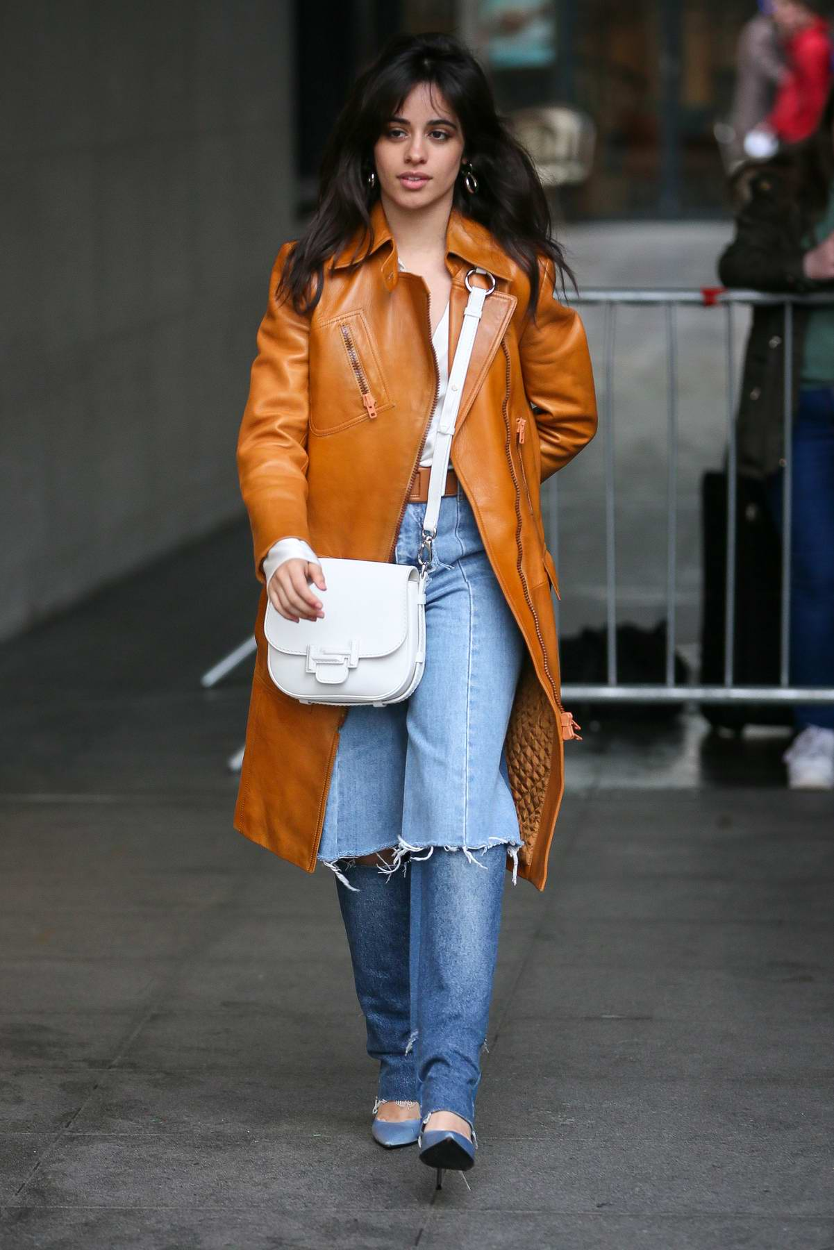 Camila Cabello spotted in an orange leather jacket as she leaves BBC Radio One in London