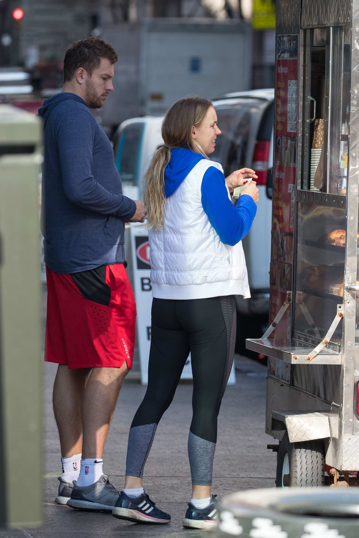 Caroline Wozniacki and fiance David Lee grab a last-minute bite at a donut van in New York City