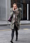 Catherine Tyldesley looked busy on a phone conversation while out in Manchester, UK