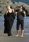 Charlize Theron spotted posing in a black outfit during a photoshoot in Malibu beach, California