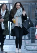 Cher Lloyd waves at the camera as she leaves ITV studios in London