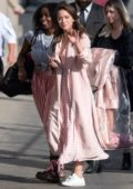 Chloe Bennet wears a pink plaid long dress with matching coat as she arrives for her appearance on Jimmy Kimmel Live in Los Angeles