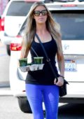 Christina El Moussa picks up a couple of juices at a local grocery store after a workout in Anaheim, California