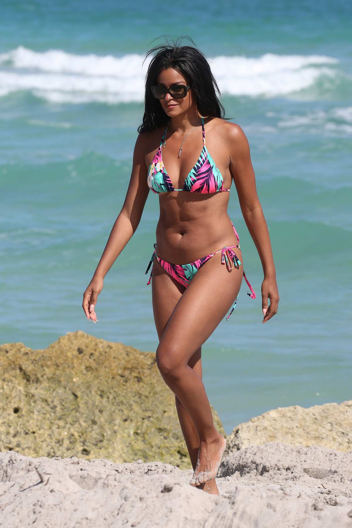 Claudia Jordan spotted in a colorful string bikini on the beach in Miami, Florida