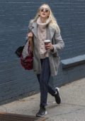 Dakota Fanning layered up as she grabs her morning coffee in New York City
