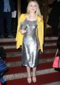 Dakota Fanning wears a silver dress with a yellow blazer as she Oscar de la Renta during New York Fashion Week in New York City