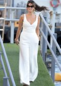 Delta Goodrem looks radiant in a white jumpsuit as she hops on a boat in Sydney, Australia