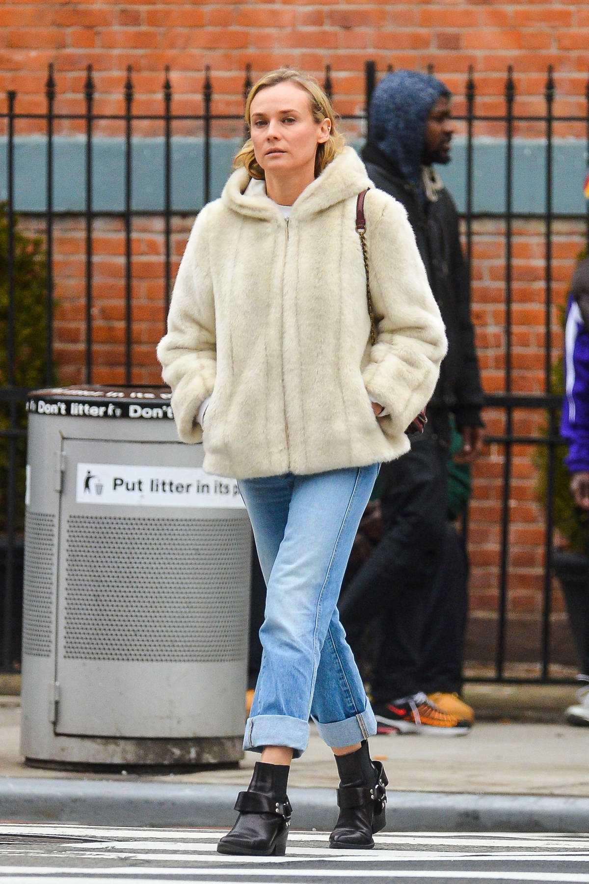 Diane Kruger out on a stroll wearing fur jacket in New York City