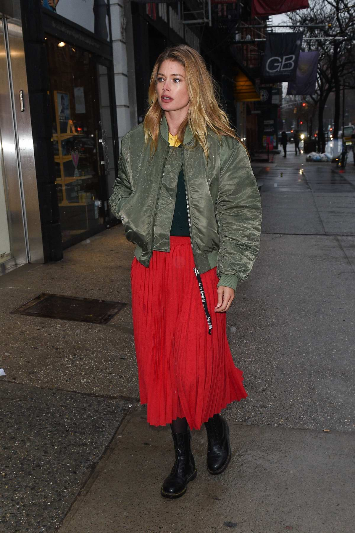 Doutzen Kroes arrives at a hair salon wearing a green jacket and red long skirt in Soho, New York