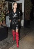 Doutzen Kroes wearing high heal red boots and PVC black jacket at Stuart Weittzman Party in New York City