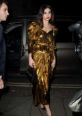 Dua Lipa in a golden dress attends the Warner Brother after-party at Freemasons in London