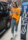 Dua Lipa wears an orange sweatshirt as she heads into SNL rehearsals in New York City
