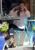 Elizabeth Olsen enjoys lunch with a friend at Artisan Cheese & Wine in Studio City, Los Angeles