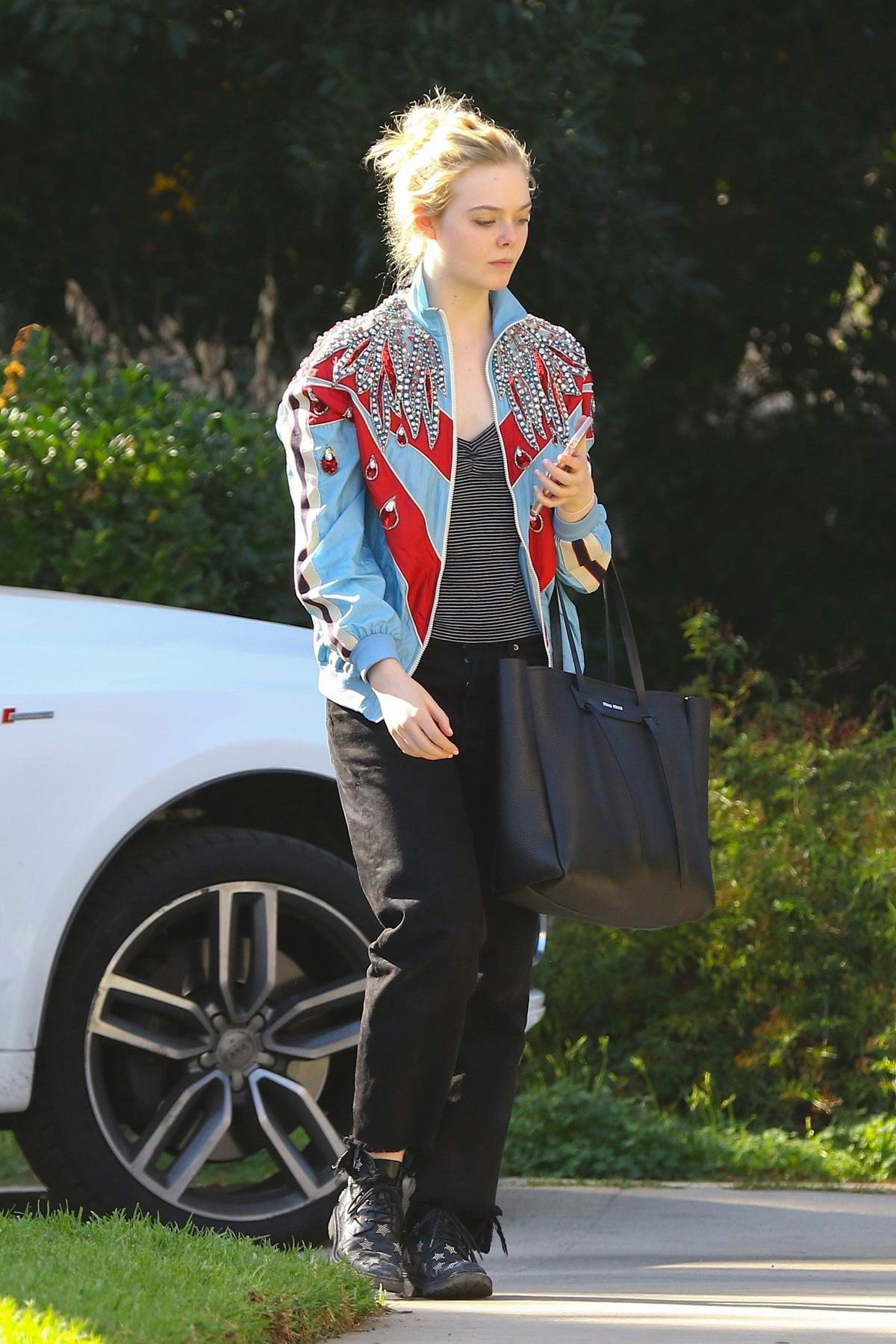 Elle Fanning sports a blue and red sequined jacket while she visit to the studio with her mother in Burbank, California