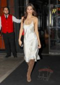 Emily Ratajkowski looks radiant in a white slip dress as stepping out for dinner in New York City