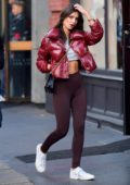 Emily Ratajkowski spotted wearing a crop top and burgundy jacket while shopping with a friend in Soho, New York City