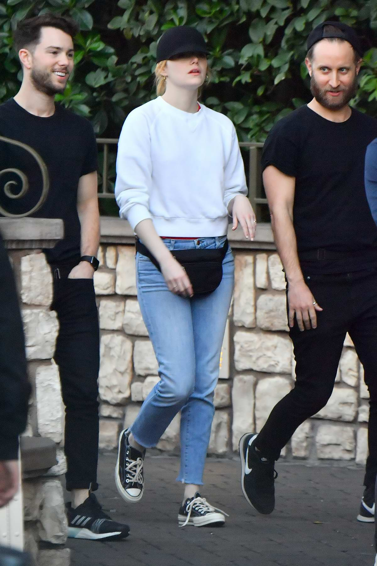 Emma Stone enjoys a day out with friends at Disneyland in Anaheim, California