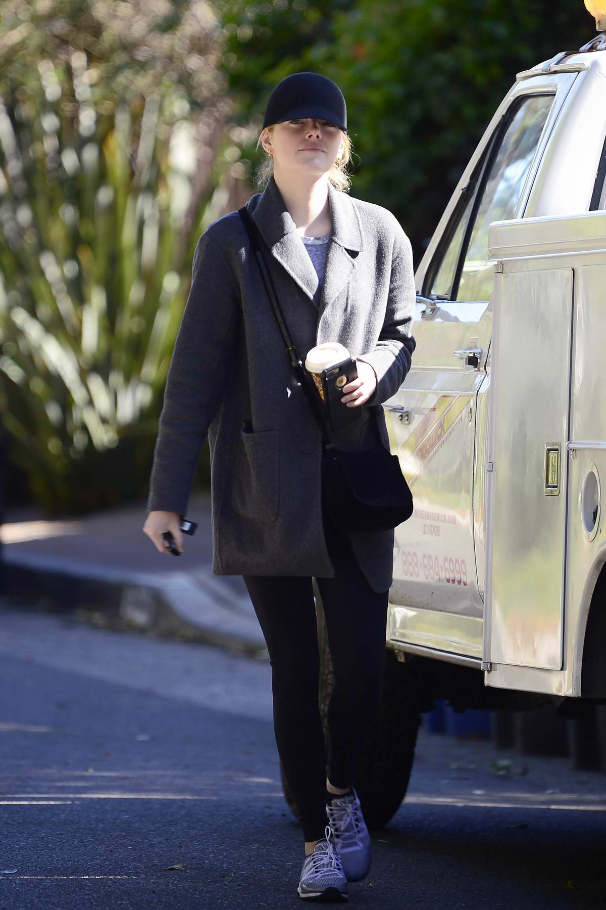 Emma Stone gives a smile while out on a stroll in Los Angeles