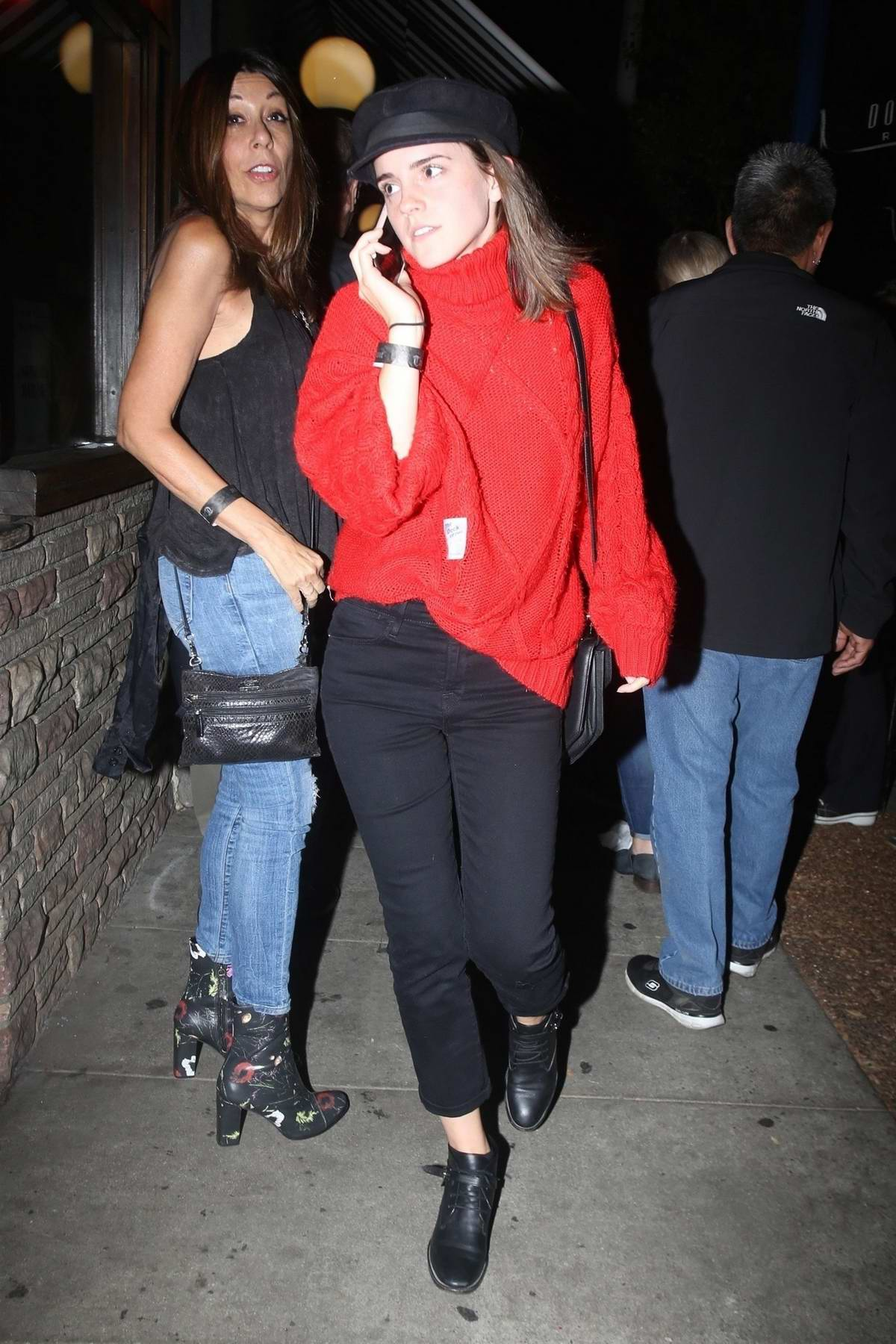 Emma Watson in a red turtleneck arrives at Troubadour for a concert in Los Angeles
