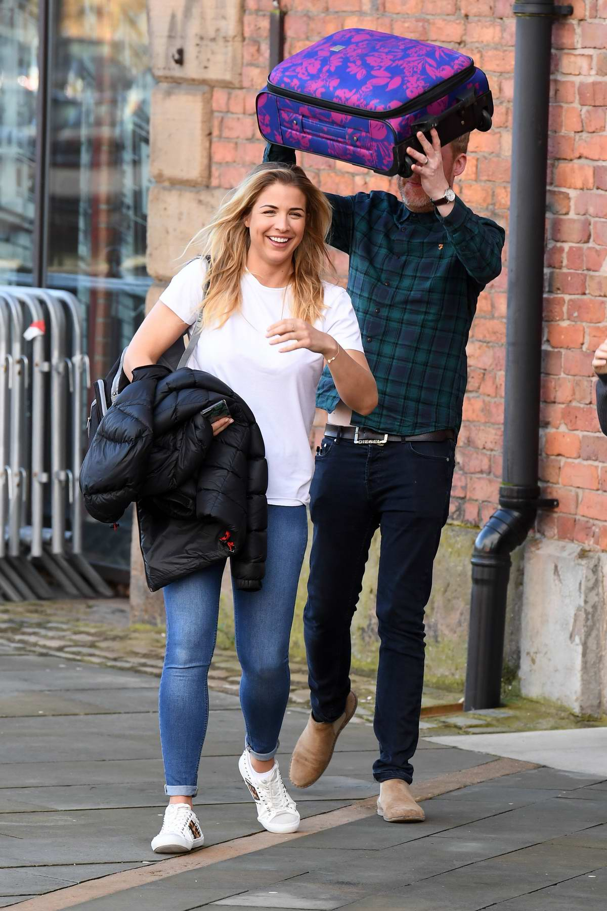 Gemma Atkinson is all smiles as she leaves Key 103 Radio in Manchester, UK