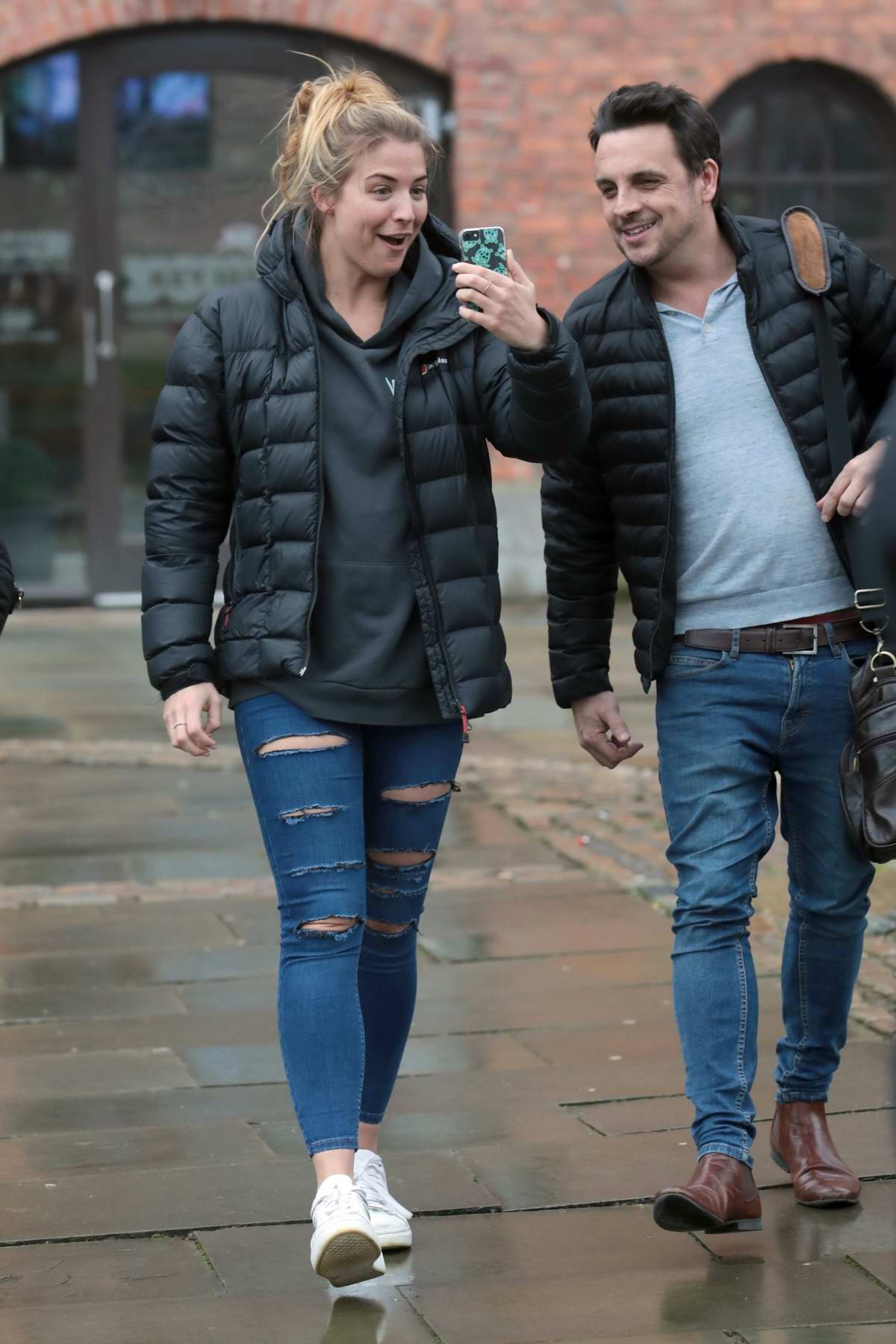 Gemma Atkinson spotted FaceTiming while she leaves Key 103 Radio in Manchester, UK