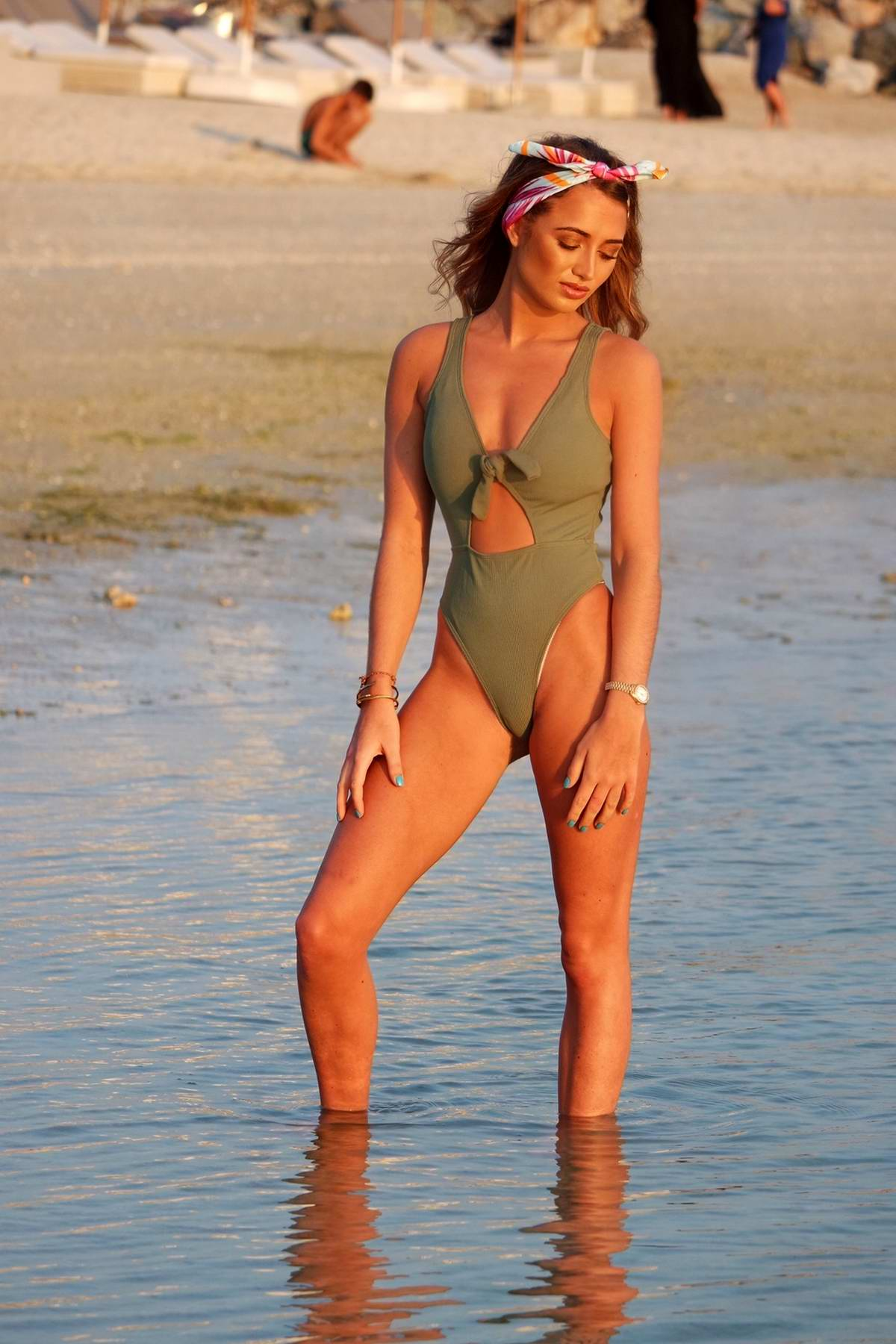 Georgia Harrison spotted wearing a green swimsuit on the beach in Dubai