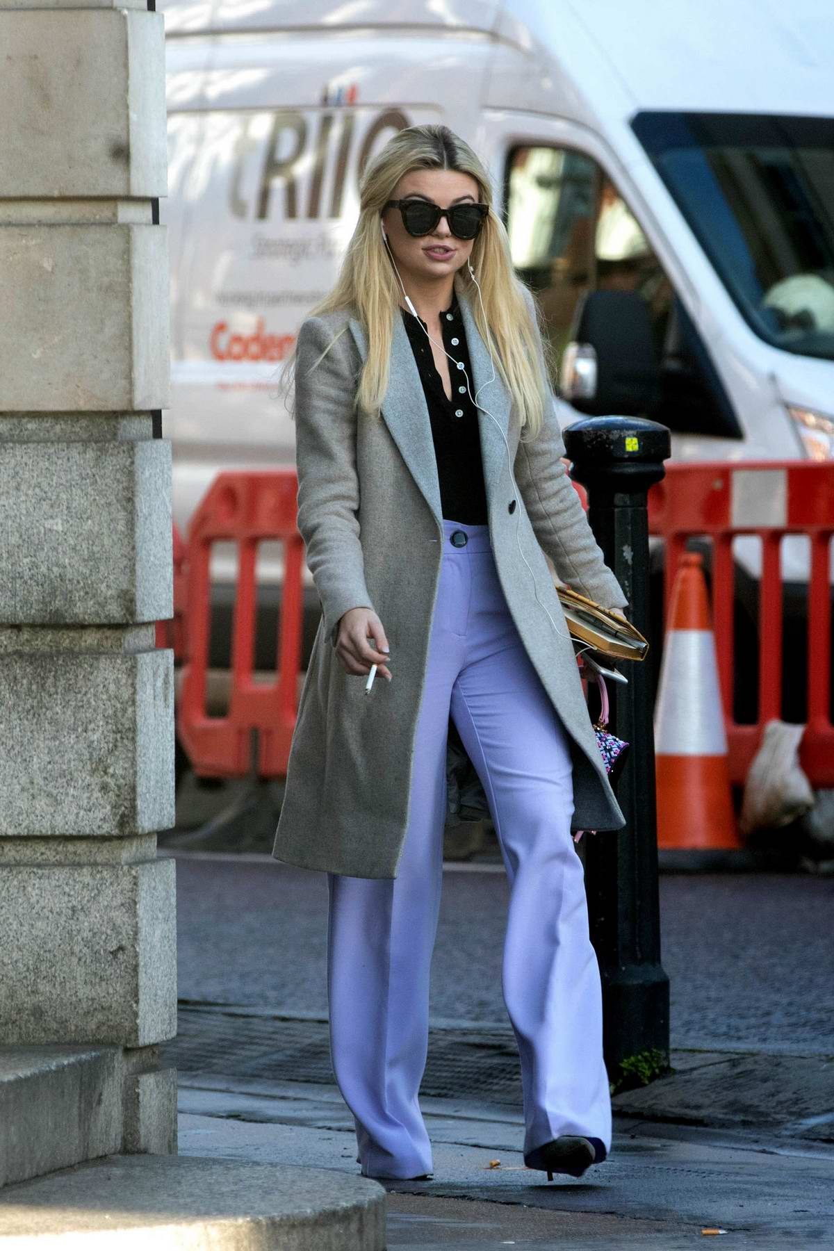 Georgia Toffolo spotted in a grey coat with a pair of bell-bottoms while out in Chelsea, London
