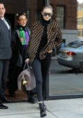 Gigi Hadid spotted leaving her apartment in a Fendi jacket to match her bag as she heads to Milan Fashion Week