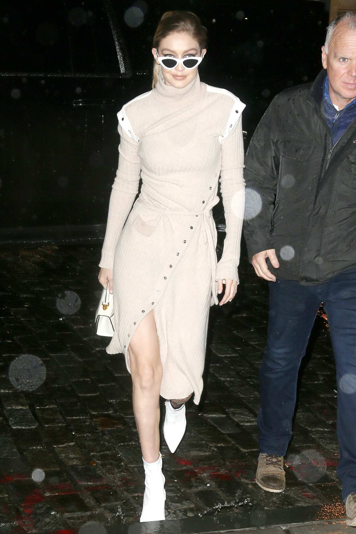 Gigi Hadid steps out in beige outfit and white boots during a night out in New York City