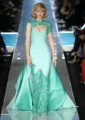 Gigi Hadid walks the runway at the Moschino Show during Milan Fashion Week in Milan, Italy