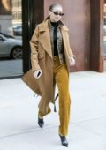 Gigi Hadid wears a mustard yellow outfit while out in New York City