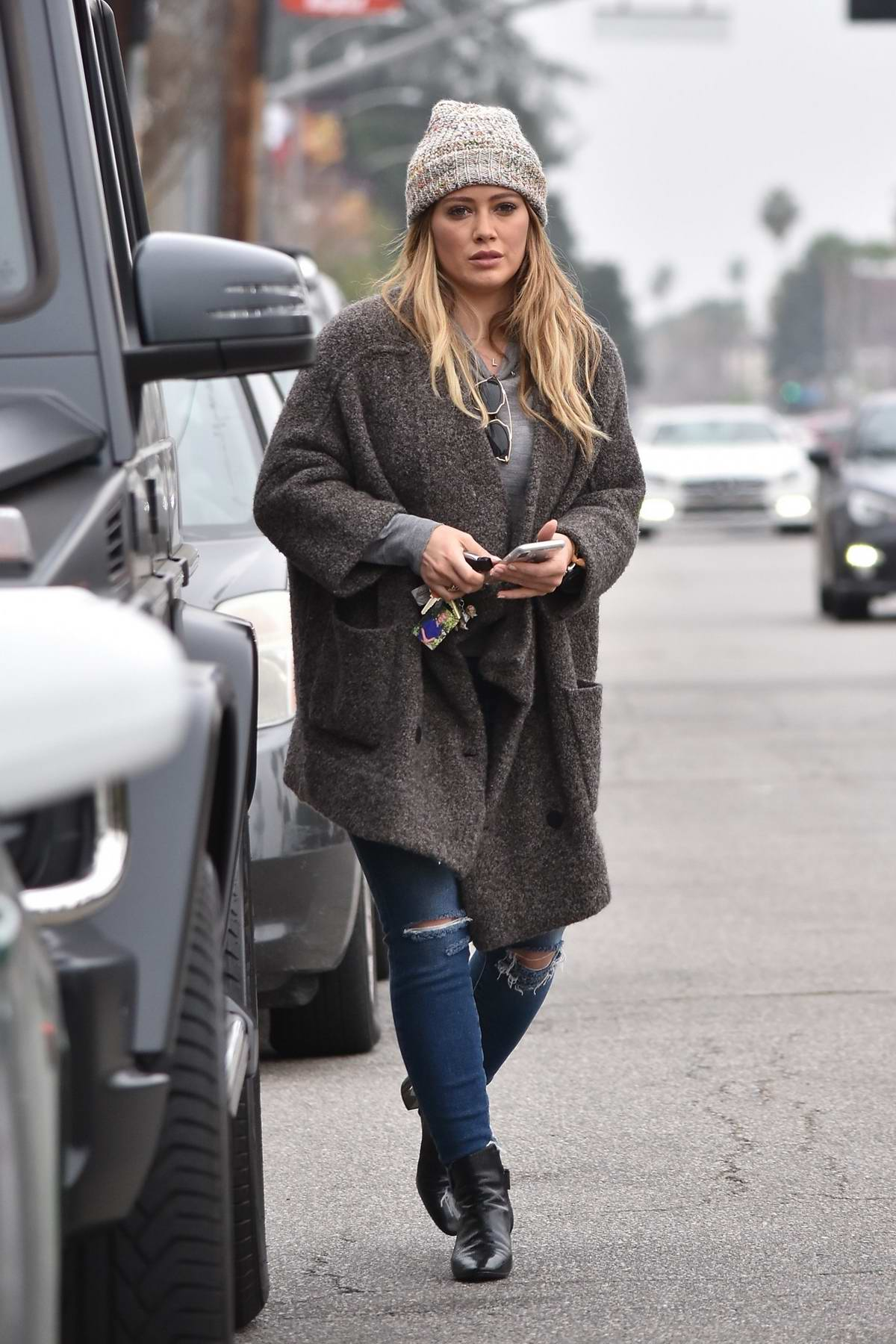 Hilary Duff wears a grey cardigan and knit beanie while out in Toluca Lake, Los Angeles