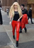 Iggy Azalea rocks bright red PVC tights with high heels and black 'Exotica' tank top to visit Z100 Studio in New York City
