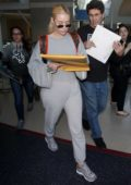 Iggy Azalea spotted in a grey sweatsuit as she arrives LAX airport in Los Angeles