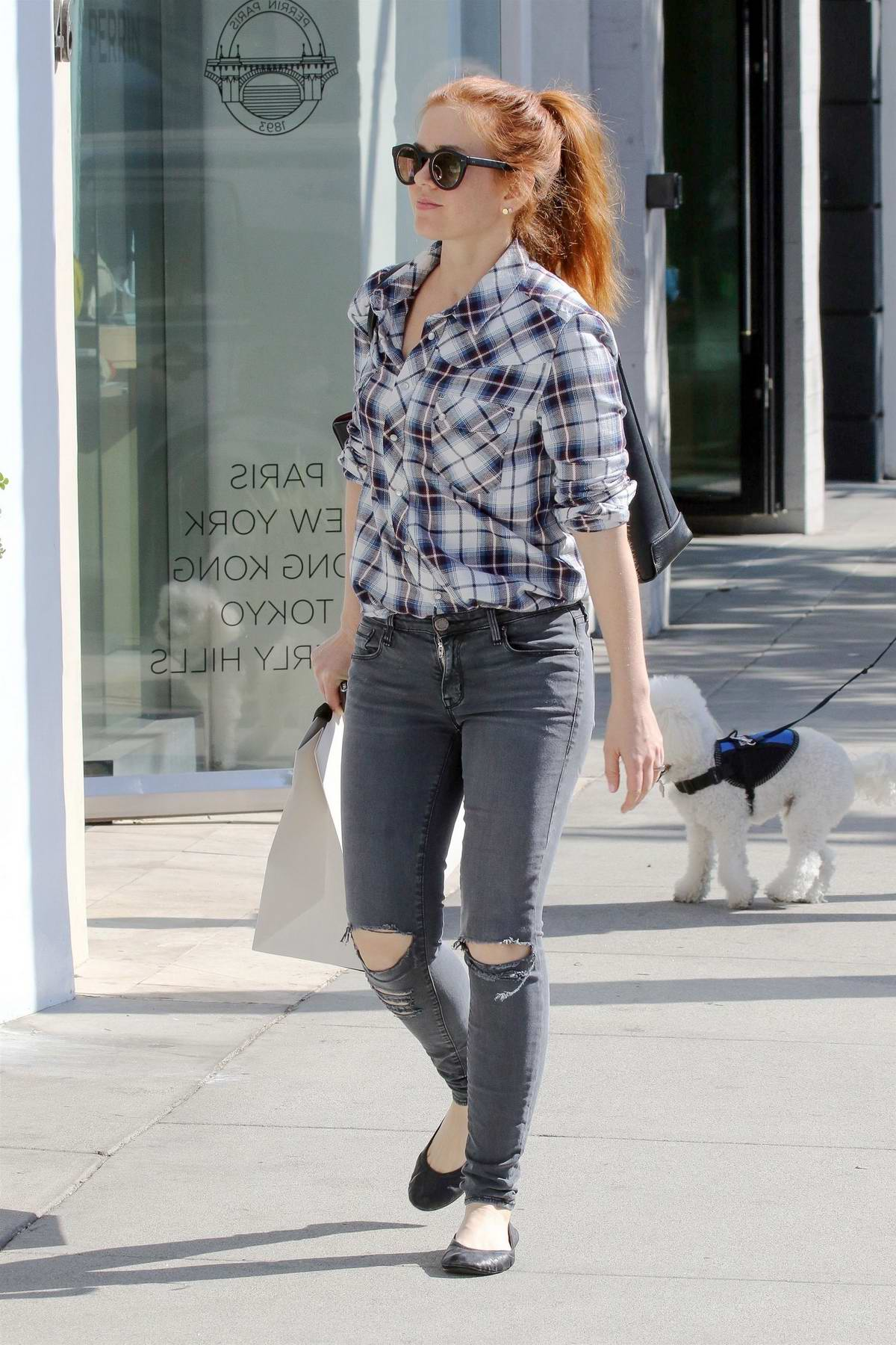 Isla Fisher rocks a plaid shirt while out shopping in Beverly Hills, Los Angeles