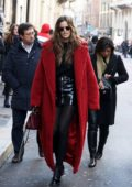 Izabel Goulart spotted in a red trench coat while out during the Fasion Week in Milan, Italy