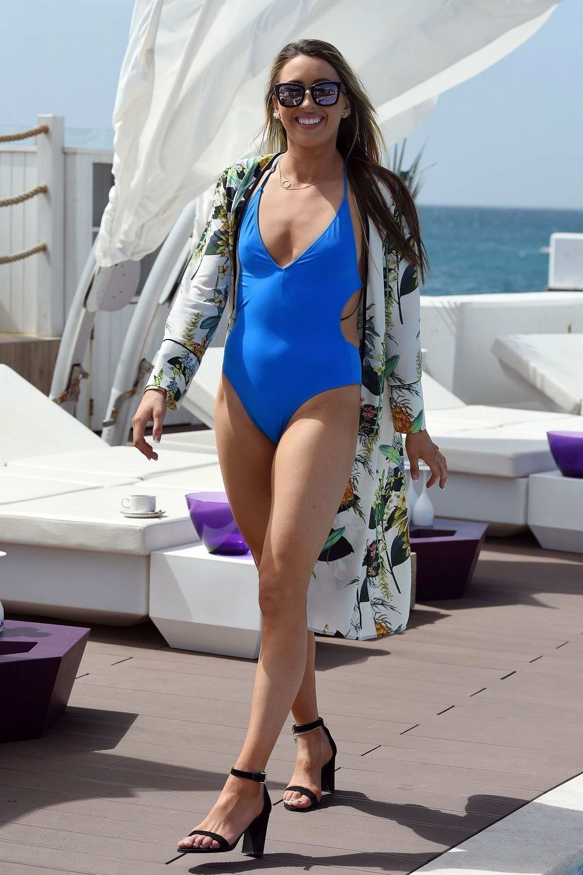 Jade Jones in a blue swimsuit attends the 'Celebs Go Dating' pool party in Cape Verde