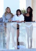 Jasmine Tookes, Romee Strijd and Taylor Hill pose during a Victoria's Secret photoshoot in Miami, Florida