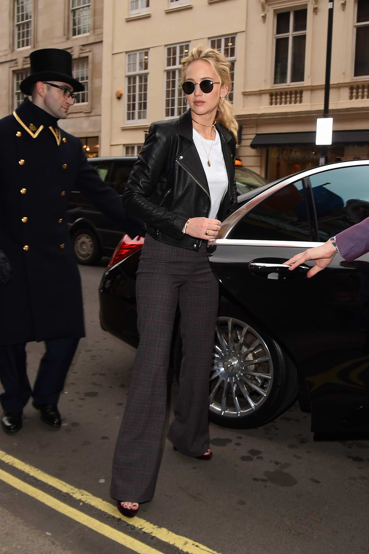 Jennifer Lawrence spotted in a black leather jacket as she arrives back to her hotel in London