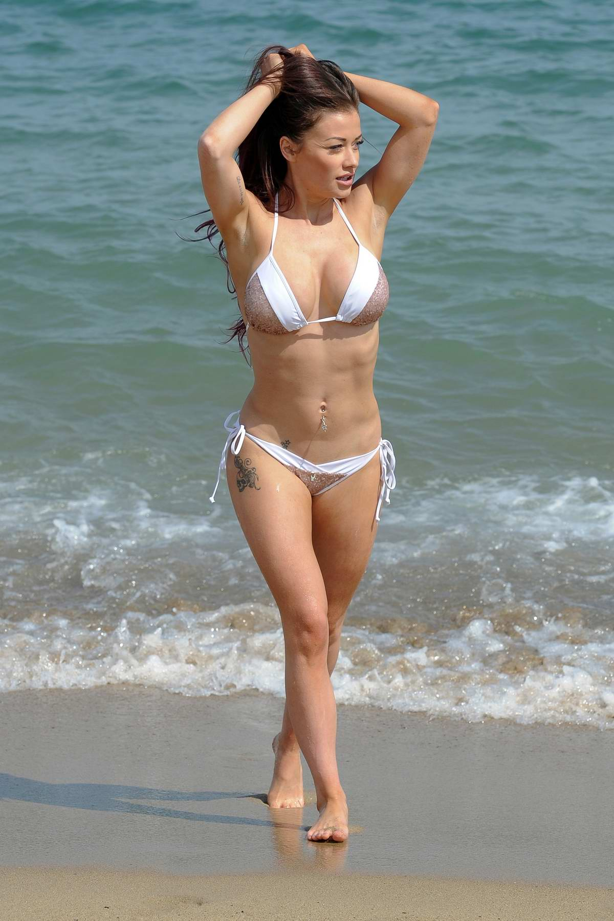 Jess Impiazzi wears a bikini as she enjoys some leisure time at the beach in Spain
