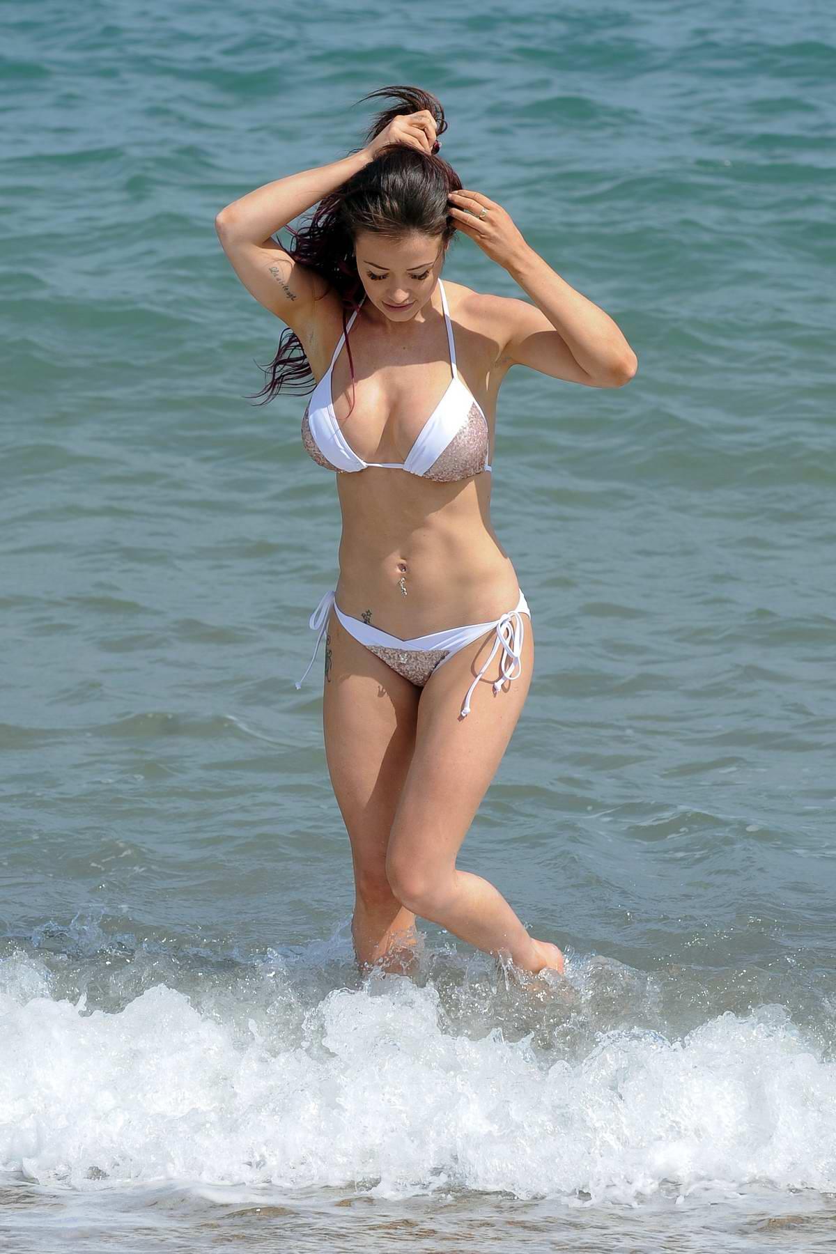 Amy Acker Bikini jess impiazzi wears a bikini as she enjoys some leisure time