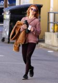 Julianne Hough wears a peach pink sweater and leggings while out in Studio City, Los Angeles