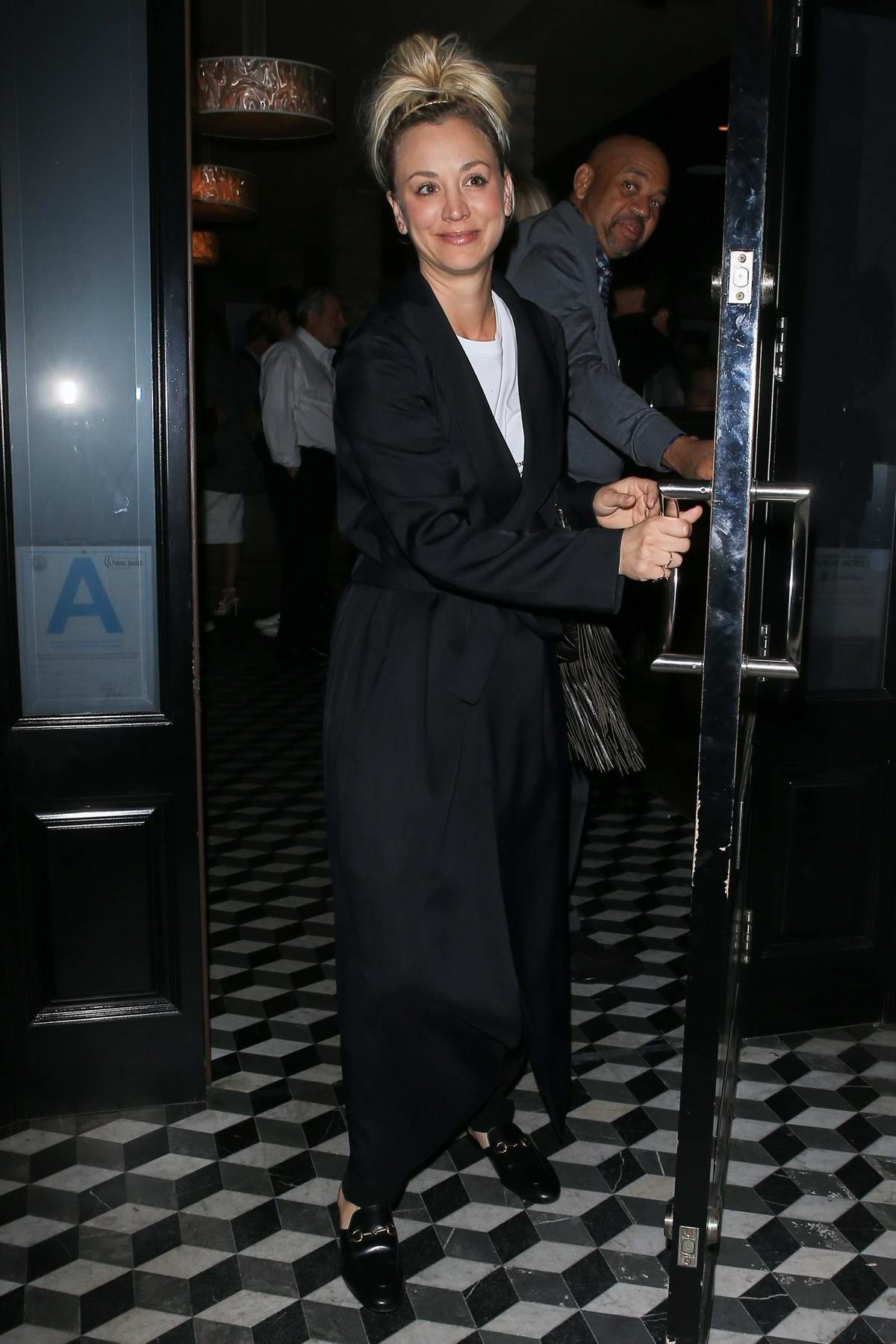 Kaley Cuoco bump into David Spade while leaving after dinner at Craig's in West Hollywood, Los Angeles