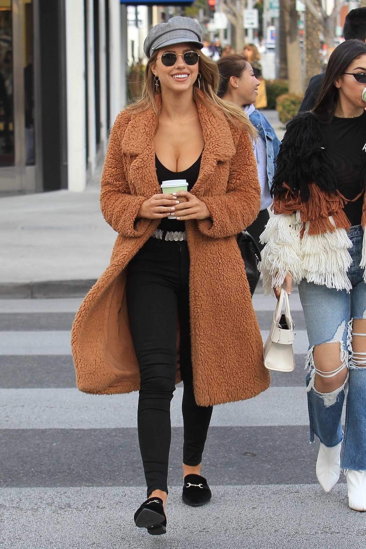 Kara Del Toro enjoys a coffee while out shopping with a friend in Beverly Hills, Los Angeles