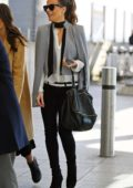 Kate Beckinsale looks stylish in grey cape as she lands at Heathrow airport in London