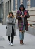 Kate Mara wearing a plaid coat, grabs coffee with a male friend in New York City