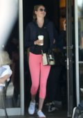 Kate Upton steps out to grab coffee wearing a blue jacket and pink leggings in Beverly Hills, Los Angeles