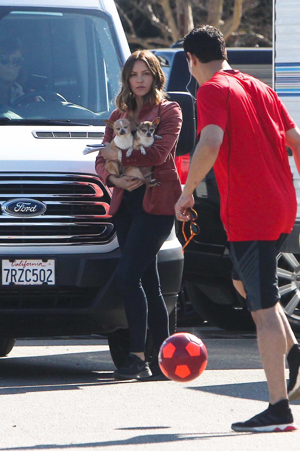 Katharine McPhee cradles her dogs on the set of 'Scorpion' in Sherman Oaks, Los Angeles
