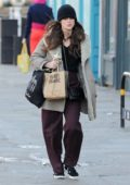 Keira Knightley wears a comfy jacket and a beanie while out for a walk after she grabbed lunch to go in North London