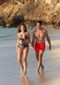 Kelly Brook dons a floral bikini while enjoying the beach with boyfriend Jeremy Parisi in Antigua